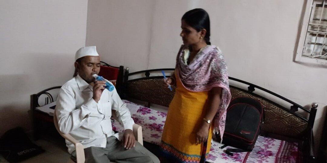 Peak flow metre being performed by community health worker